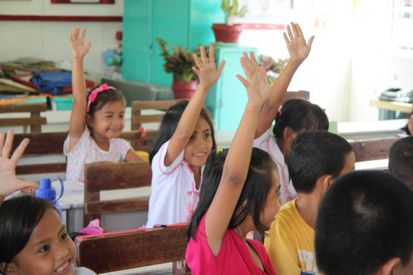 Students at Dulag SPED Central School interacting with Save the Children staff.