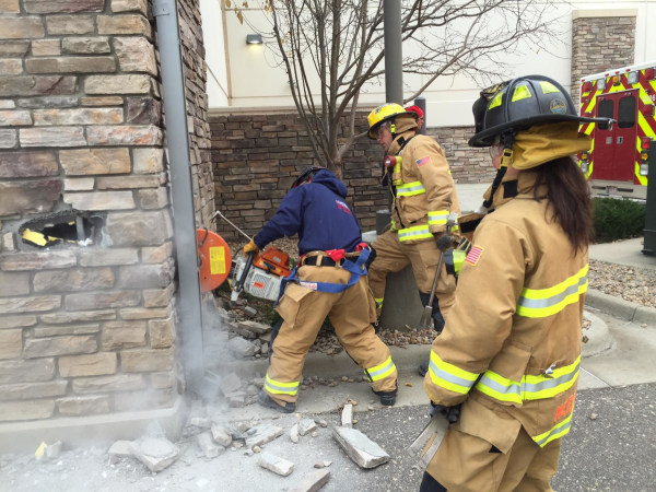 Image: Firefighters rescued a man from the wall of a Marshall's store in Longmont, Colorado