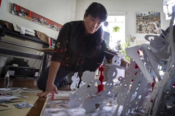 Image: Colette Fu has spent decades researching and documenting the lives of China's ethnic minorities, publishing in the form of beautiful, intricate, hand-cut paper pop-up books