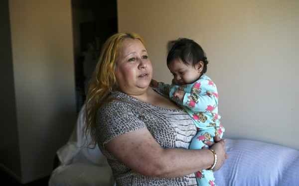 Image: Maria Guerrero holds her 14-month-old daughter
