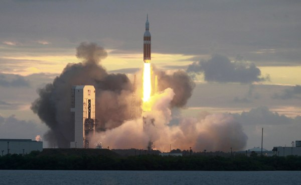 Image: The Delta IV Heavy rocket with the Orion spacecraft lifts off from the Cape Canaveral Air Force Station in Cape Canaveral