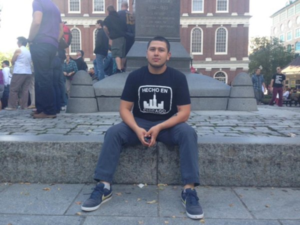 Image: Jaime Hermosillo sits in Quincy Market in Boston, Mass.