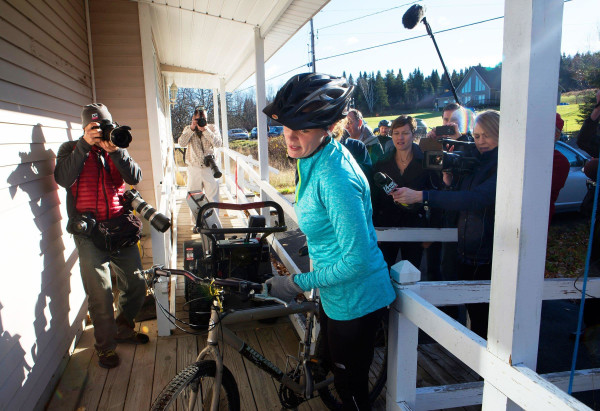 Image: Kaci Hickox returns to her home surrounded by media after going for a bike ride with boyfriend Ted Wilbur in Fort Kent