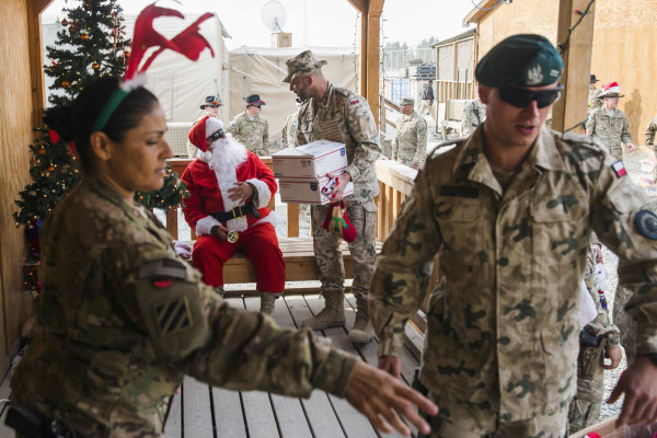 Image: U.S. soldiers from the 3rd Cavalry Regiment pass out care packages and Christmas stockings to fellow soldiers and workers on forward operating base Gamberi in the Laghman province of Afghanistan