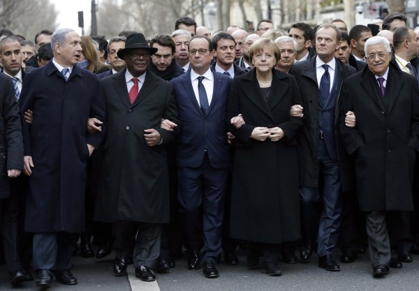 Image: French President Francois Hollande (3rd L) is surrounded by head of states (From L to R : Benyamin Netanyahu of Istarel, Ibrahim Boubakar Keita of Mali, Angela Merkel of Germany, EU Coucil President Donald Tusk and Palestinian Mahmud Abbas) as they