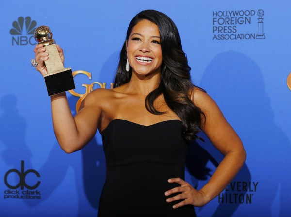 Image: Gina Rodriguez poses with her award during the 72nd Golden Globe Awards in Beverly Hills