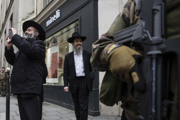 Image: Armed security forces stand outside a Jewish school in Paris on Monday