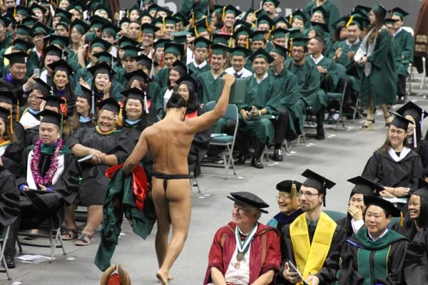 Kalā Kaawa did not plan on stripping off his graduation gown while receiving his diploma, but the last-minute call earned him a standing ovation.