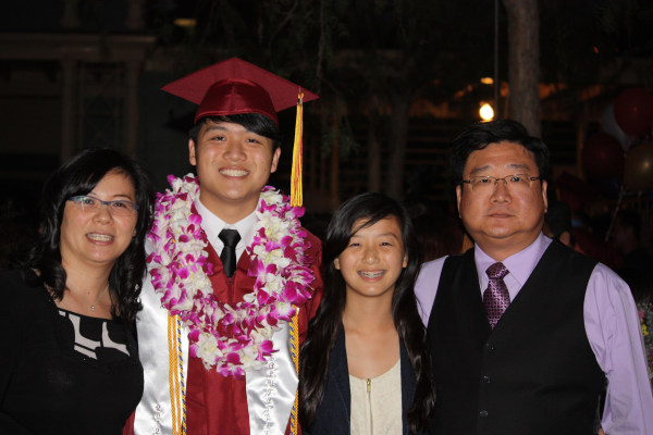 Alton Wang (second from left) celebrates his high school graduation at the Santa Anita racetrack in Arcadia, California with his family June, 2012.