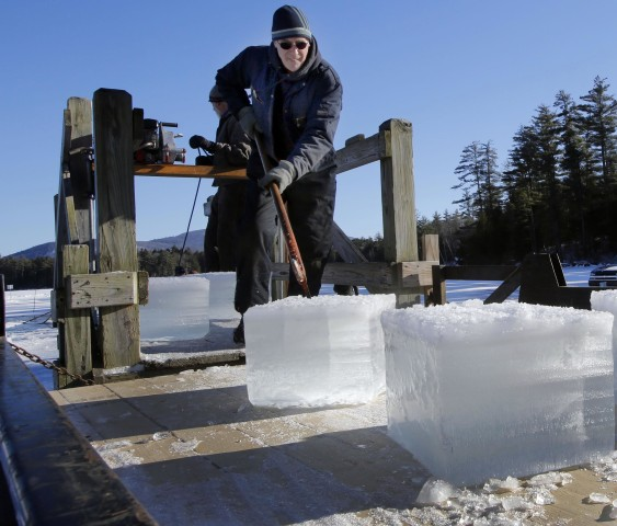 Image: Dave Lacasse loads blocks of ice weighing 120 to 160 pounds during there annual ice harvest