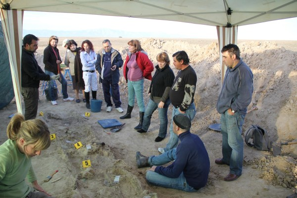 Image: A group assembles during a 2010 excavation and subsequent exhumation of 7 people who were shot and killed in a fusilade on November 1936 during Spain's Civil War.