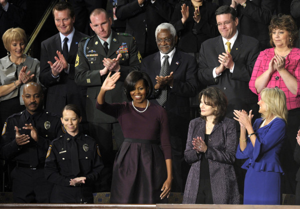 , Mark Todd of Killeen, Texas, Kimberly Munley of Killeen, Texas, Mrs. Obama, Rebecca Knerr of Chantilly, Va. and Jill Biden, wif eof Vice President Joe Biden. Sdecod row, from left are, Chris Lardner of Albuquerque, N.M., Trevor Yegar of Indianapolis, Sg