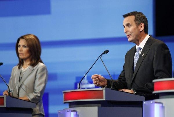 Tim Pawlenty speaks beside Michele Bachmann during the Republican presidential debate in Ames