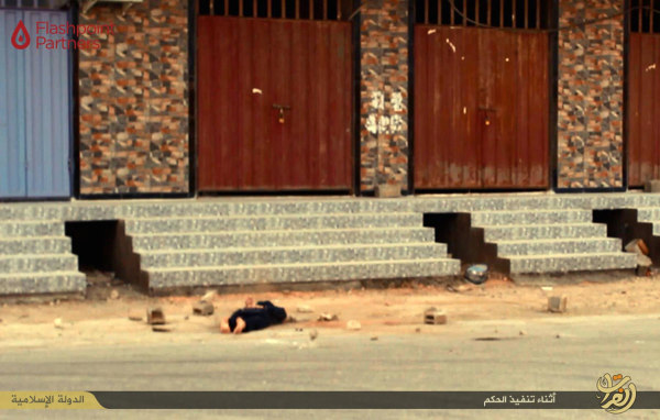 Image: Photo released by ISIS appears to show the body of an alleged gay man after his execution
