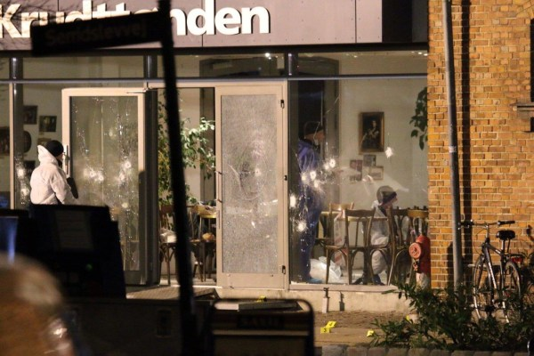 Image: Forensic investigators are seen at the site of a shooting in Copenhagen
