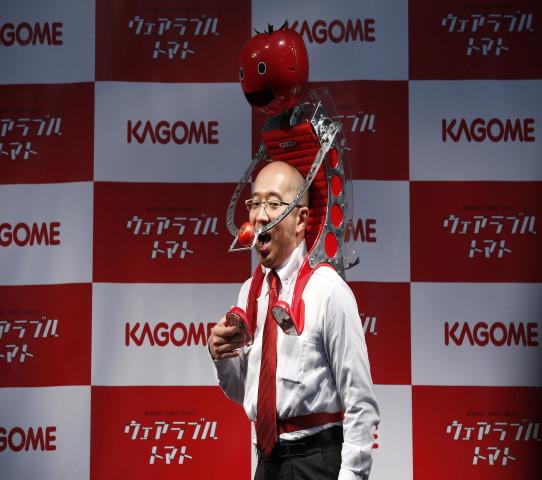 Image: Kagome Co's employee Shigenori Suzuki poses with the device