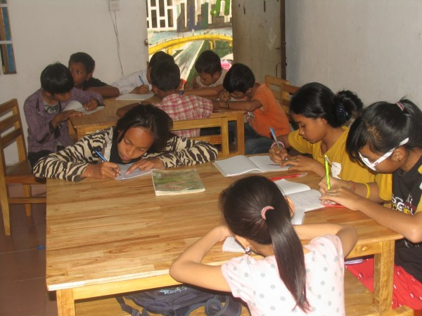 Tiny Toones' students can't just study hip hop and breakdancing. Sobil ensures the kids study English, Khmer, math, and history.