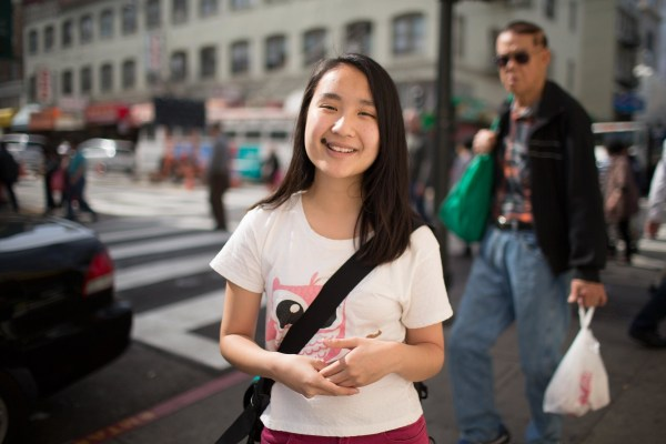 Image:Rosa Chen stands in Chinatown where she gives historical tours with the Chinatown Community Development Center.
