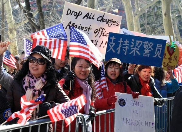 Hundreds of supporters rallied for NYPD Officer Peter Liang in Lower Manhattan this weekend.