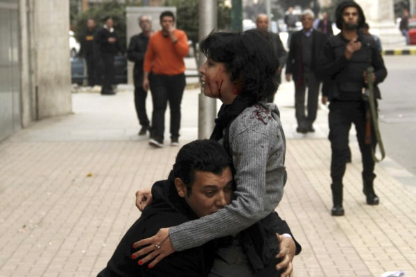 Image: SPAP activist Sabbagh receives help after she was shot during a protest by the party in Cairo