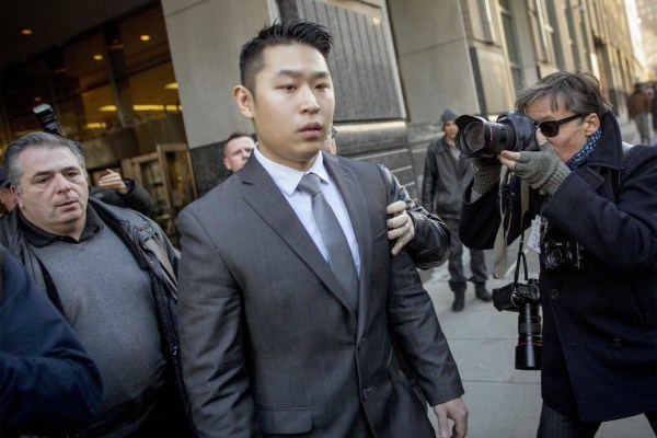 Image: NYPD officer Peter Liang departs the criminal court after an arraignment hearing in the Brooklyn borough of New York City