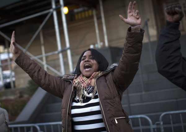 Image: Erica Garner, the daughter of Eric Garner leads a chant at a protest and candlelight vigil outside the 120th police precinct in the Staten Island borough of New York City