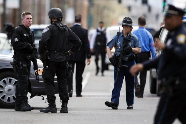 Image: Law enforcement officers react to a suspect they deemed a threat on Arsenal St, in the search area for Dzhokar Tsarnaev, the one remaining suspect in the Boston Marathon bombing, in Watertown