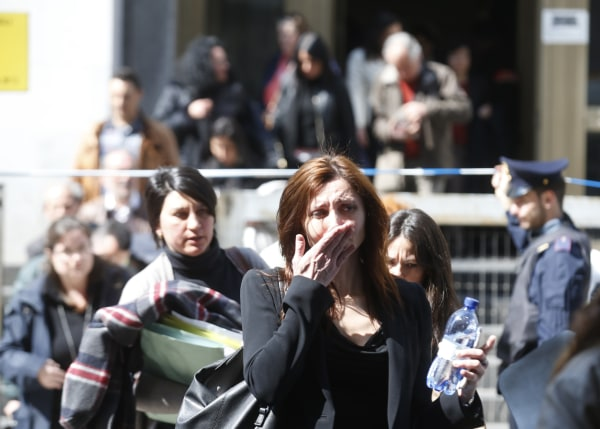 Image: Woman cries near tribunal building in Milan, Italy