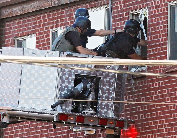 IMAGE: Police at James Holmes' apartment
