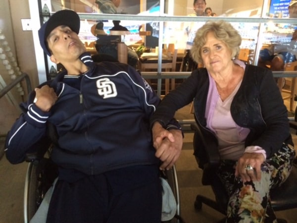 Image:  Matt LaChappa sits with Priscilla Oppenheimer, the longtime director of minor league operations for the San Diego Padres.
