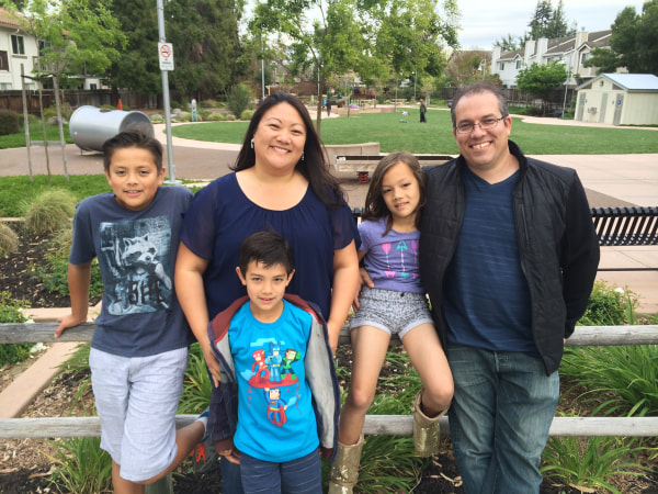 Image: Malisa with her mom, Michelle Honda-Phillips, dad Travis Phillips and brothers Zachary and Trey