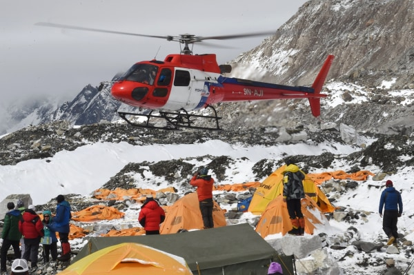 Image: A rescue helicopter comes in for a landing to pick up the injured from Everest Base Camp on April 26, 2015.