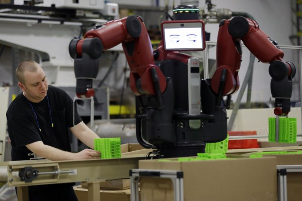 Image: A technician works with Baxter, an adaptive robot in Hatfiled, Pa.