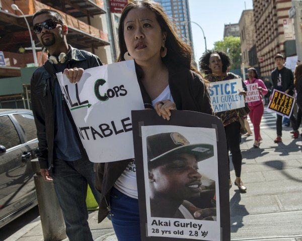 Image: Demonstrators protest outside the Brooklyn Supreme Courthouse in the Brooklyn borough of New York