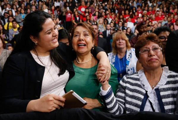 Image: Lorella Praeli, Chela Praeli and Ligia Jimenez (L-R) listen to U.S. President Barack Obama speak about immigration reform