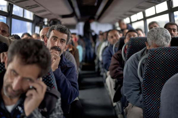 Image: Palestinian laborers on bus in 2013