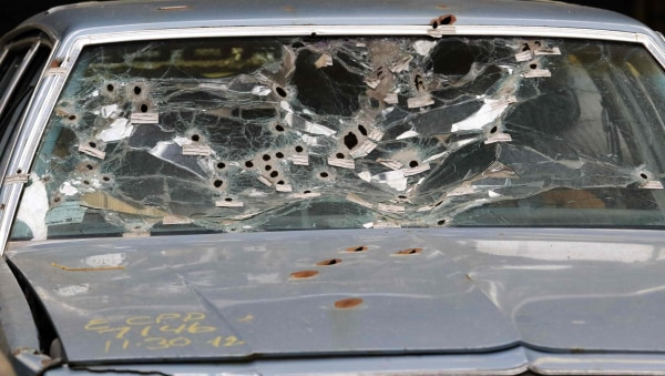 Image: Timmothy Russell's windshield is shown during a mock up of the crime scene during manslaughter trial for a police officer in Cleveland