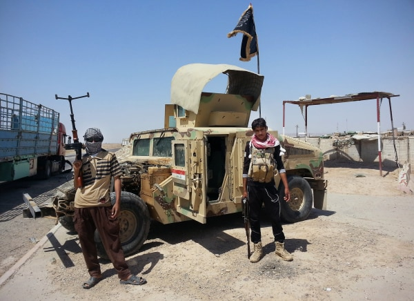 Image: ISIS militants with a captured Humvee in Iraq on June 19, 2014