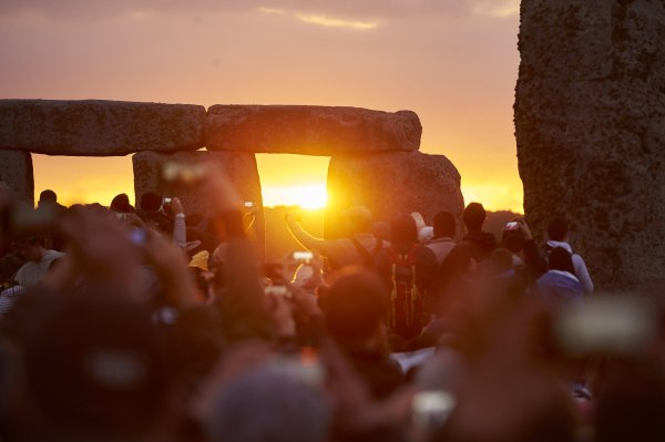 Image: Revelers celebrate the pagan festival of Summer Solstice at Stonehenge.