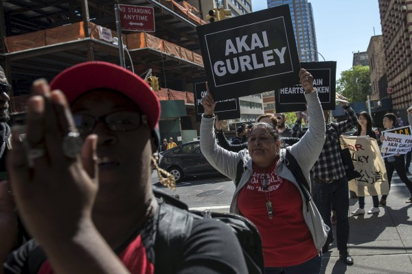 Image: Demonstrators protest outside the Brooklyn Supreme Courthouse in Brooklyn borough of New York
