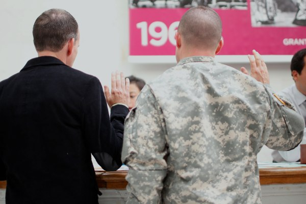 Image: Todd Saunders and U.S. Army Captain Michael Potoczniak take oath