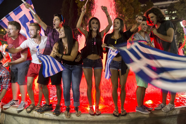 """No"" supporters celebrate referendum results on a street in central in Athens"