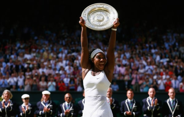 Image: Serena Williams of the United States celebrates with the Venus Rosewater Dish