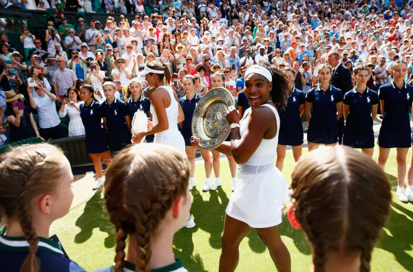Image: Serena Williams leaves court with the Venus Rosewater Dish after her victory
