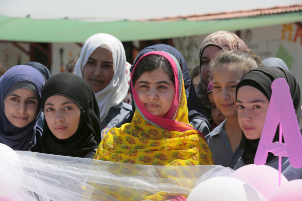 Image: Malala poses with girls for a picture at a school for Syrian refugee girls