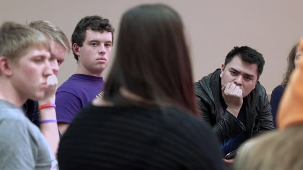 """Image: Jose Antonio Vargas talks with young people in the documentary """"White People."""""""