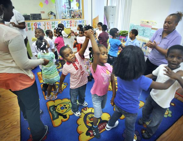 Students dance to La Bamba in a Harlem Gems preschool class, part of the Harlem Childrens Zone program
