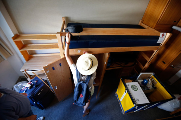 Image: A freshmen student moves into her dorm in UCLA