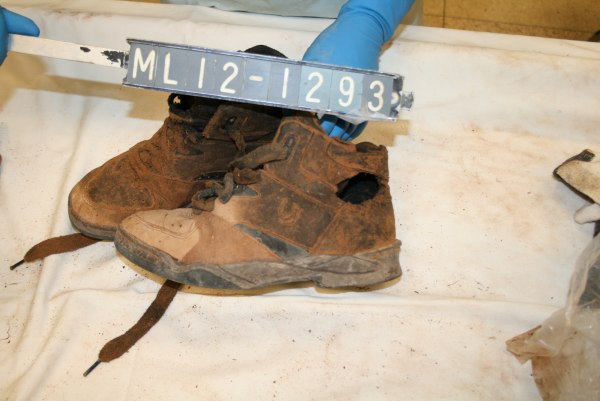 Image: Shoes that belong to a missing person whose body was found along the border, but hasn't been identified.