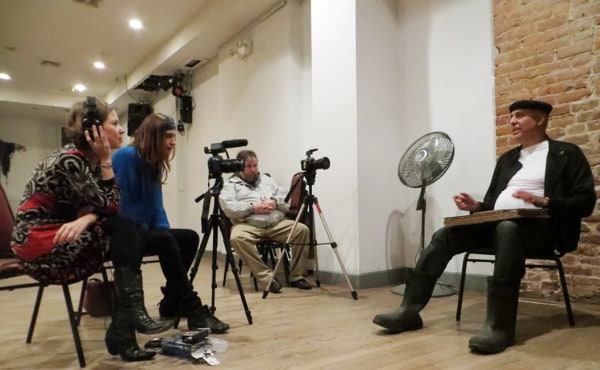 Image: Documentary filmmaker Celia Novis interviews Max Vazquez, a member of La Nacional.